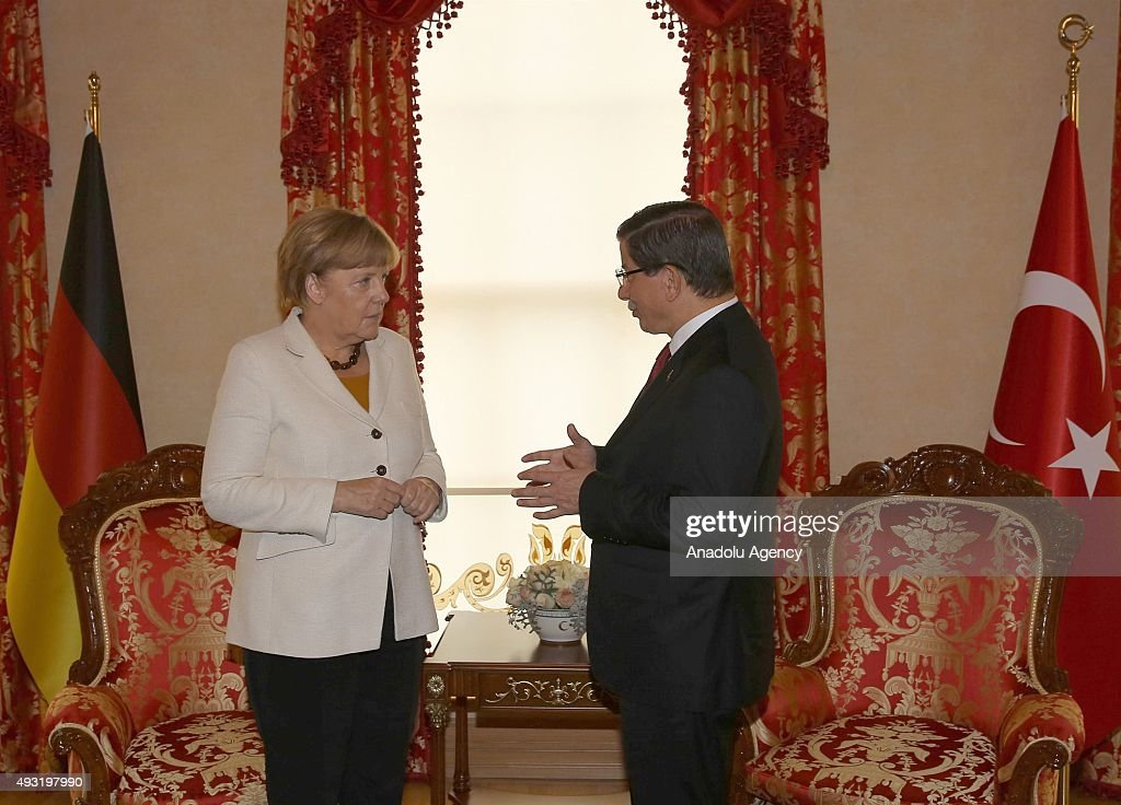 Turkish Prime Minister Ahmet Davutoglu (R) meets with German Chancellor Angela Merkel (L) at Prime Ministerial Office in Dolmabahce Palace in Istanbul, Turkey on October 18, 2015.
