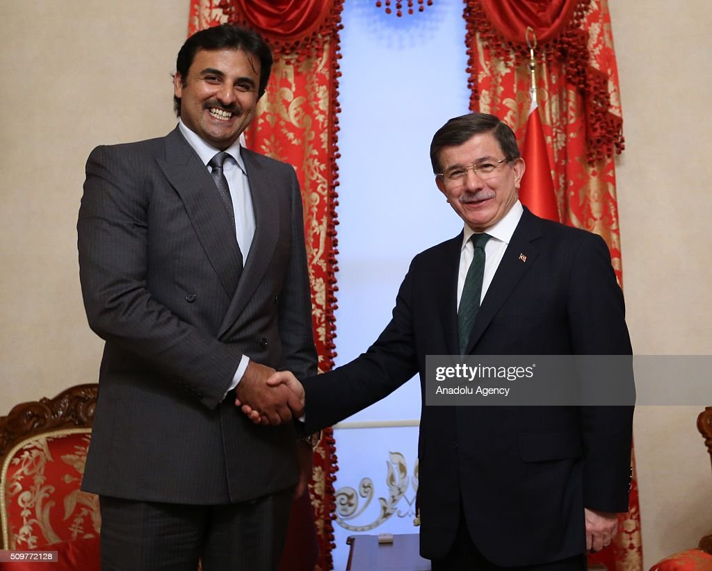 Turkish Prime Minister Ahmet Davutoglu (R) shakes hands with Qatar's Emir Sheikh Tamim bin Hamad Al Thani (L) at the Dolmabahce Prime Ministry Office in Istanbul, Turkey on February 12, 2016.