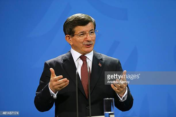 Turkish Prime Minister Ahmet Davutoglu speaks during a press conference after a meeting with German Chancellor Angele Merkel in Berlin Germany on...