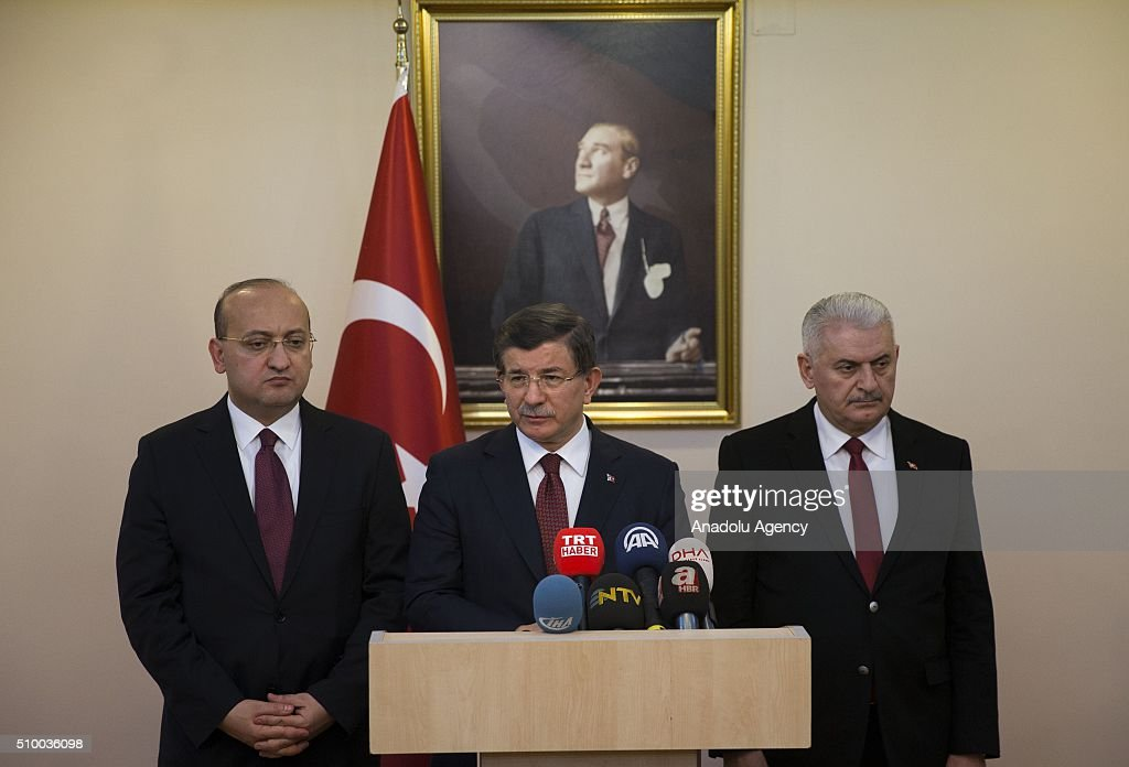 Turkish Prime Minister Ahmet Davutoglu (C) speaks to the media at the Erzincan Airport in Erzincan, Turkey on February 13, 2016.