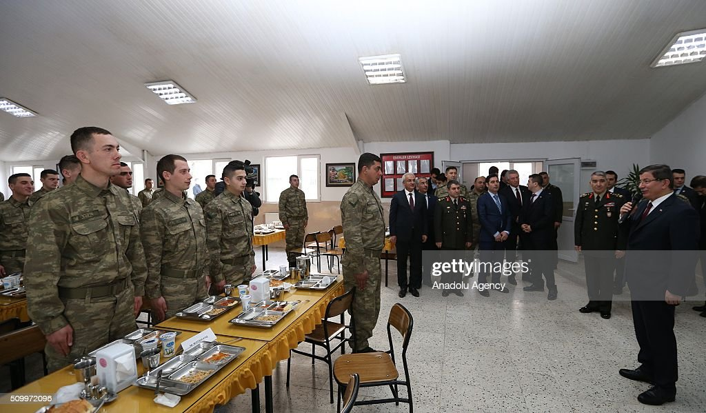 Turkish Prime Minister Ahmet Davutoglu (R) together with 3rd Army Commander General Ismail Serdar Savas (R 2) visits the 3rd Army Commandership in Erzincan, Turkey on February 13, 2016.