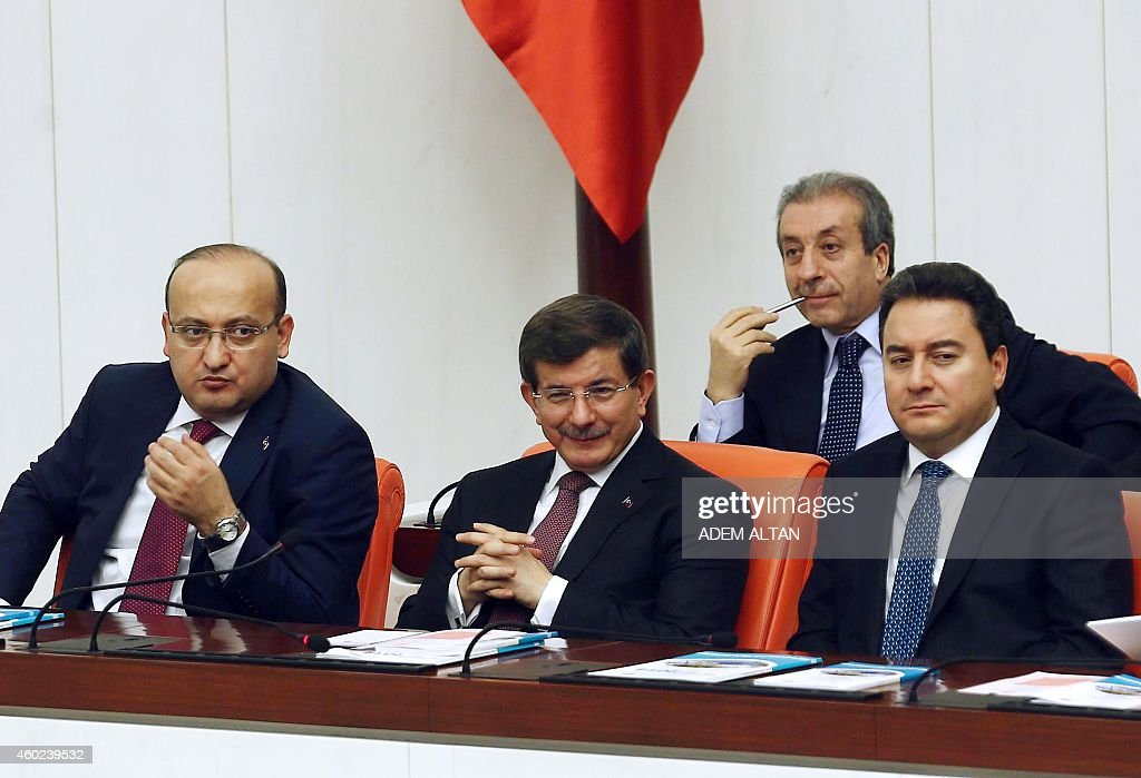 Turkish Prime Minister Ahmet Davutoglu (C), Turkey's Deputy Prime Minister <a gi-track='captionPersonalityLinkClicked' href=/galleries/search?phrase=Ali+Babacan&family=editorial&specificpeople=612964 ng-click='$event.stopPropagation()'>Ali Babacan</a> (R) and politician Yalcin Akdogan (L) take part in a debate on the government's budget for 2015 in Ankara, on December 10, 2014.