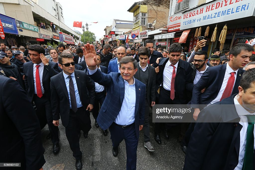 Turkish Prime Minister Ahmet Davutoglu waves his hand to citizens after performing friday prayer in his hometown Konya, Turkey on May 6, 2016.