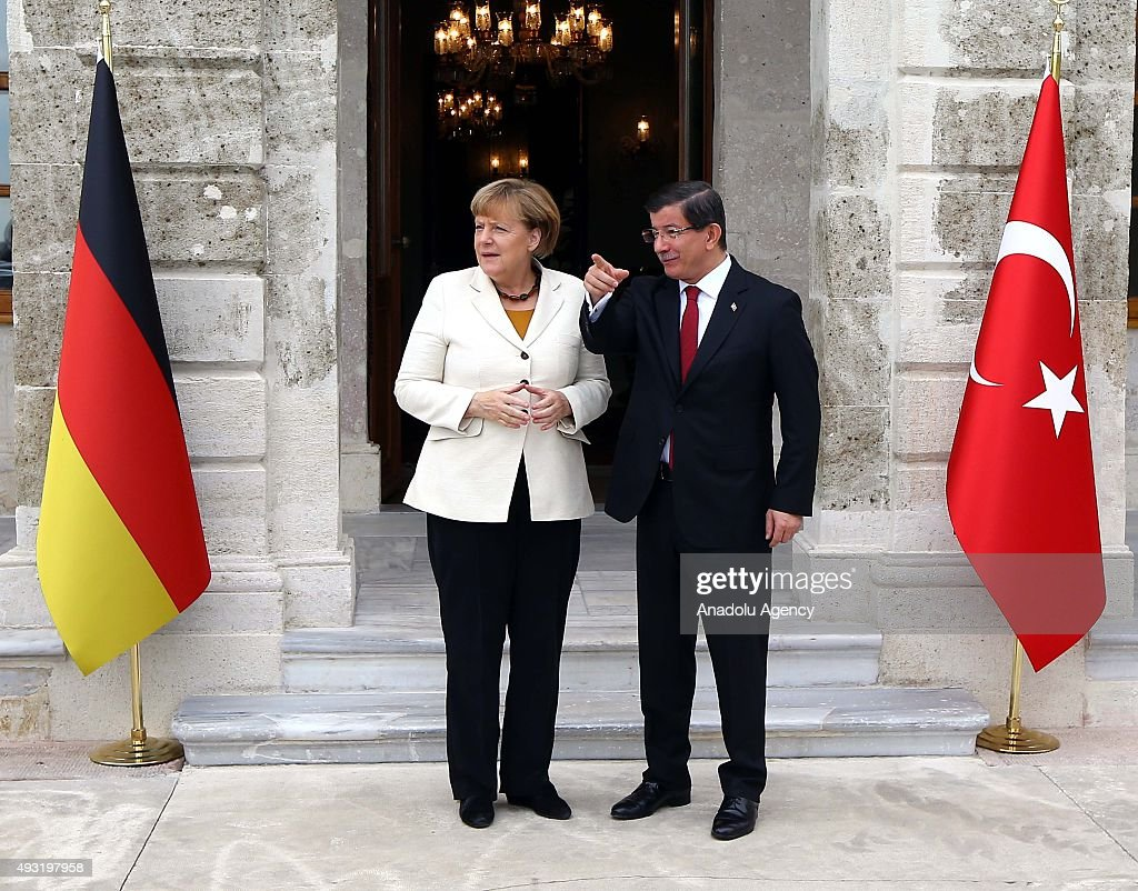 Turkish Prime Minister Ahmet Davutoglu (R) welcomes German Chancellor Angela Merkel (L) before their meeting at Dolmabahce Palace in Istanbul, Turkey on October 18, 2015.