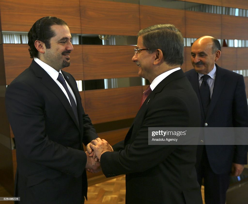 Turkish Prime Minister Ahmet Davutoglu (2nd L) welcomes the Al-Mustaqbal movement leader and the former Prime Minister of Lebanon Saad Hariri (L) piror to their meeting in Istanbul, Turkey on April 30, 2016.