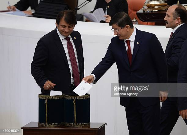 Turkish Prime Minister and Justice and Development Party leader Ahmet Davutoglu votes for the election of the Parliament speaker at the Turkish Grand...