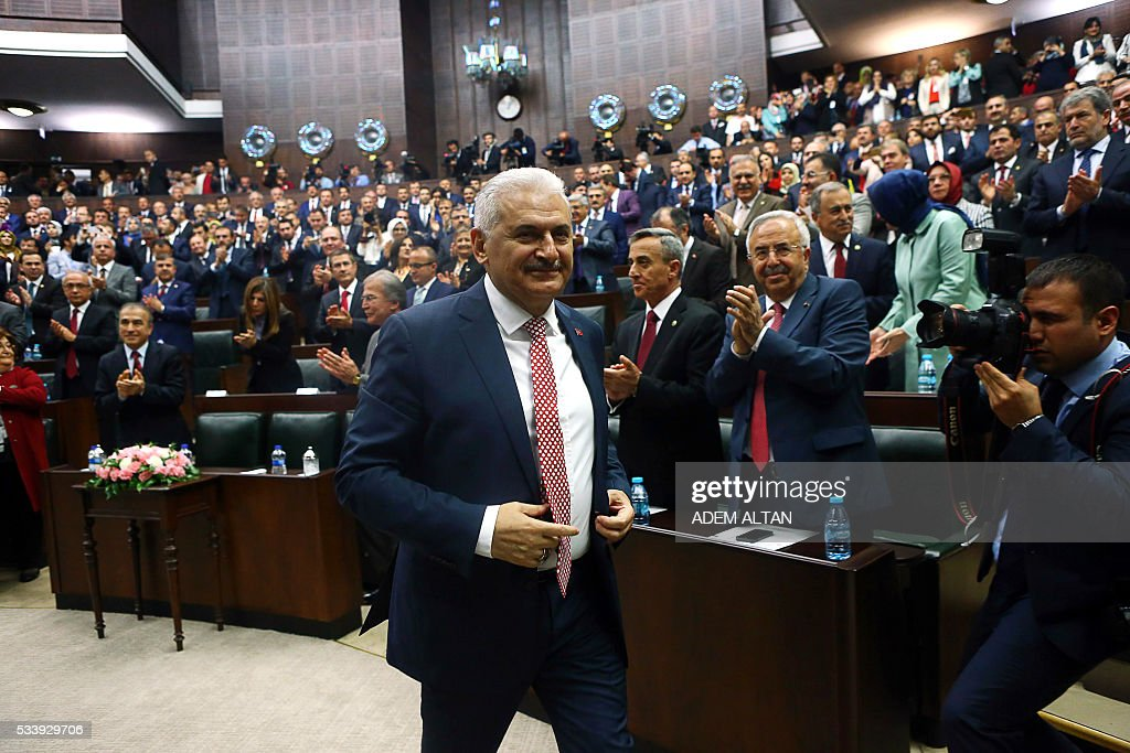 Turkish Prime Minister and leader of Turkey's ruling party Justice and Development Party (AKP) Binali Yildrim arrives for an AKP meeting at the Grand National Assembly of Turkey (TBMM) in Ankara, on May 24, 2016. Turkey's incoming Prime Minister Binali Yildirim on May 24 unveiled his new cabinet line-up two days after being given a mandate by President Recep Tayyip Erdogan, with most key ministers keeping their jobs but the EU minister switched. / AFP / ADEM