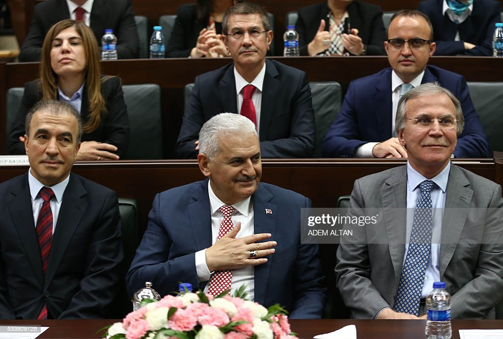 Turkish Prime Minister and leader of Turkey's ruling party Justice and Development Party (AKP) Binali Yildrim gestures during an AKP meeting at the Grand National Assembly of Turkey (TBMM) in Ankara, on May 24, 2016. Turkey's incoming Prime Minister Binali Yildirim on May 24 unveiled his new cabinet line-up two days after being given a mandate by President Recep Tayyip Erdogan, with most key ministers keeping their jobs but the EU minister switched. / AFP / ADEM