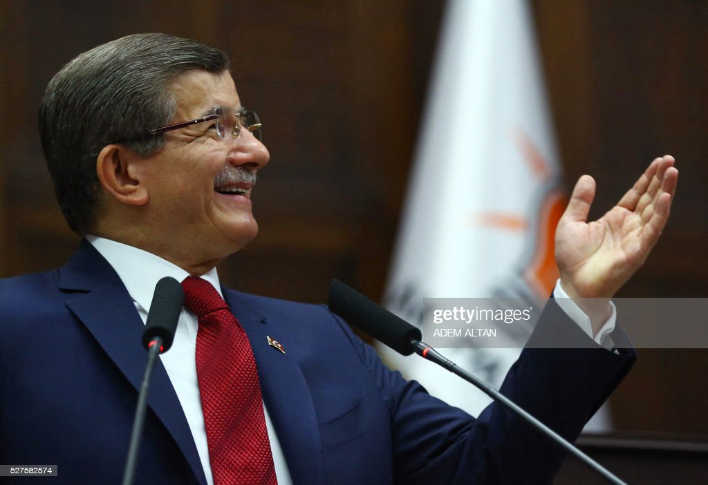 Turkish Prime Minister and leader of Turkey's ruling party, the Justice and Development Party (AKP) Ahmet Davutoglu gestures as he speaks during an AKP meeting at the Grand National Assembly of Turkey (TBMM) in Ankara, on May 03, 2016. / AFP / ADEM