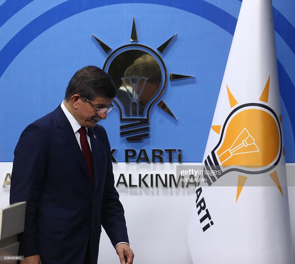 Turkish Prime Minister and leader of Turkey's ruling party, the Justice and Development Party (AK Party) Ahmet Davutoglu leaves after giving a press conference after an executive board meeting of his Justice and Development Party in Ankara, on May 5, 2016. Ahmet Davutoglu announced he would not be seeking a new mandate as ruling party chief at a extraordinary party congress on May 22, meaning he will step down as prime minister. / AFP / ADEM