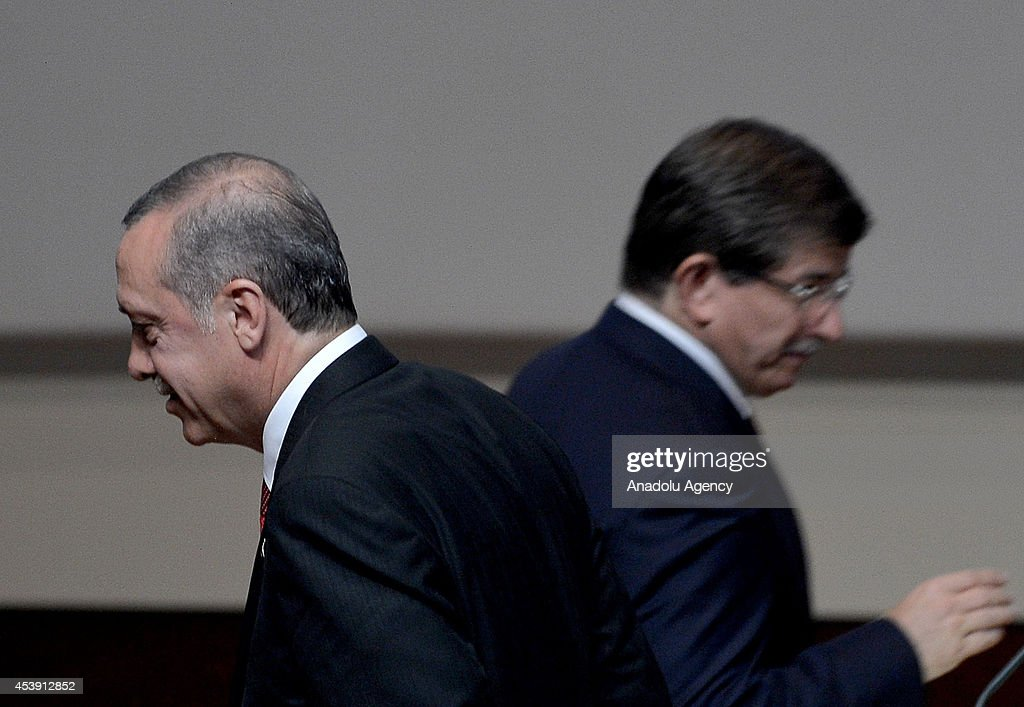 Turkish Prime Minister and the head of Turkeys ruling Justice and Development Party (AK Party) Recep Tayyip Erdogan (L) and Turkish Foreign Minister <a gi-track='captionPersonalityLinkClicked' href=/galleries/search?phrase=Ahmet+Davutoglu&family=editorial&specificpeople=4940018 ng-click='$event.stopPropagation()'>Ahmet Davutoglu</a> (R) are seen during the congress in which Davutoglu is nominated as the new chairman of AK Party on August 21, 2014, at the headquarters of the party, for the First Extraordinary Congress that will be held on August 27, in Ankara, Turkey.