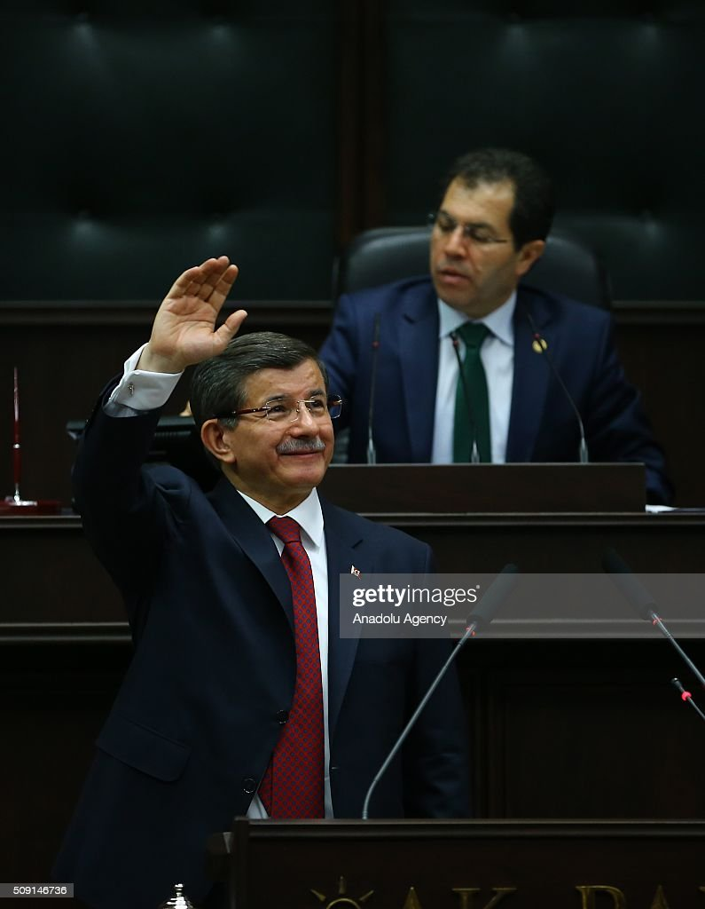 Turkish Prime Minister and the leader of the Justice and Development Party (AK Party) Ahmet Davutoglu salutes MPs before he delivers a speech during AK Party's group meeting at the Grand National Assembly of Turkey (TBMM) in Ankara, Turkey on February 09, 2016.