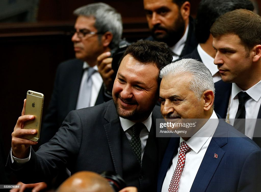 Turkish Prime Minister and the leader of Turkey's ruling party, the Justice and Development Party (AK Party) Binali Yildirim (R) attends AK Party's group meeting at the Grand National Assembly of Turkey (TBMM) in Ankara, Turkey on May 24, 2016.