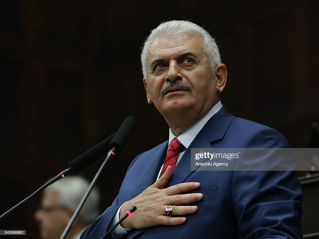 Turkish Prime Minister and the leader of Turkey's ruling party, the Justice and Development Party (AK Party) Binali Yildirim greets during AK Party's group meeting at the Grand National Assembly of Turkey (TBMM) in Ankara, Turkey on June 28, 2016.