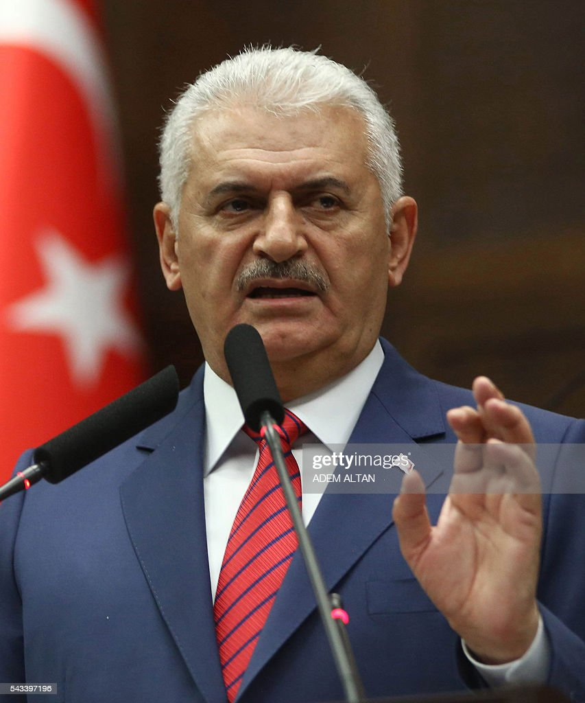 Turkish Prime Minister and the leader of Turkey's ruling party, the Justice and Development Party (AK Party) Binali Yildirim delivers a speech during a meeting of the AK Party at the Grand National Assembly of Turkey (TBMM) in Ankara, on June 28, 2016. / AFP / ADEM