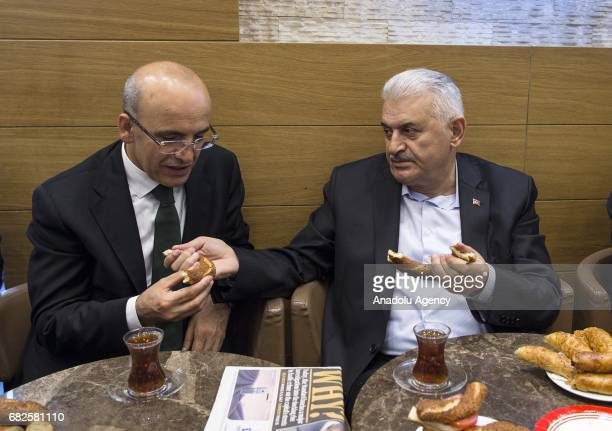 Turkish Prime Minister Binali Yildirim accompanied by Deputy PM Hayati Yazici are seen at a traditional Turkish bagel bakery in London England on May...
