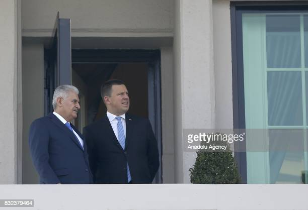 Turkish Prime Minister Binali Yildirim and Estonian Prime Minister Juri Ratas are seen at the balcony of Cankaya Palace after the welcoming ceremony...
