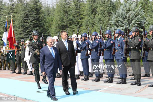 Turkish Prime Minister Binali Yildirim and Estonian Prime Minister Juri Ratas review the troops during an official welcome ceremony prior to their...