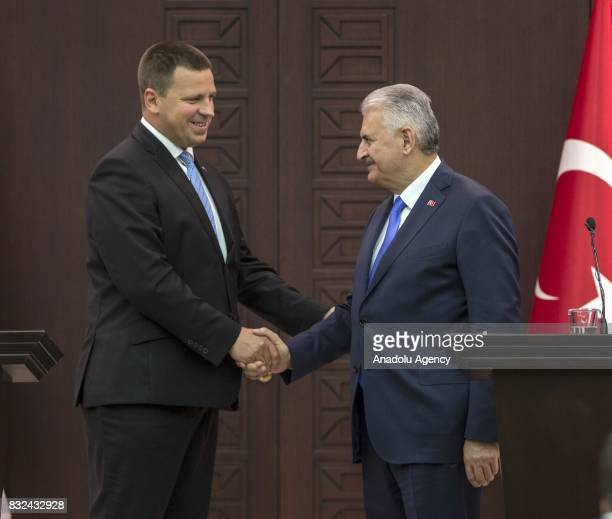 Turkish Prime Minister Binali Yildirim and Estonian Prime Minister Juri Ratas shake their hands after holding a joint press conference following...