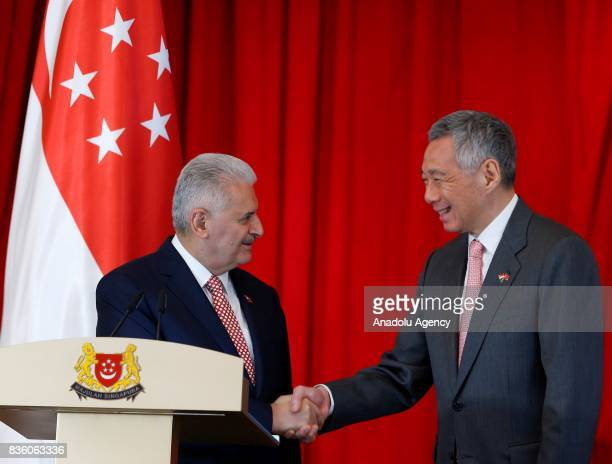Turkish Prime Minister Binali Yildirim and Singapore's Prime Minister Lee Hsien Long shake hands as they hold a press conference after their meeting...