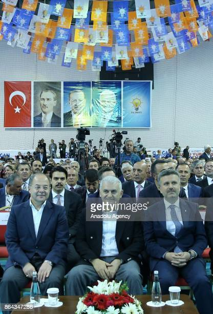 Turkish Prime Minister Binali Yildirim and Turkish Deputy Prime Minister Recep Akdag attend the Turkey's ruling Justice and Development Party's...