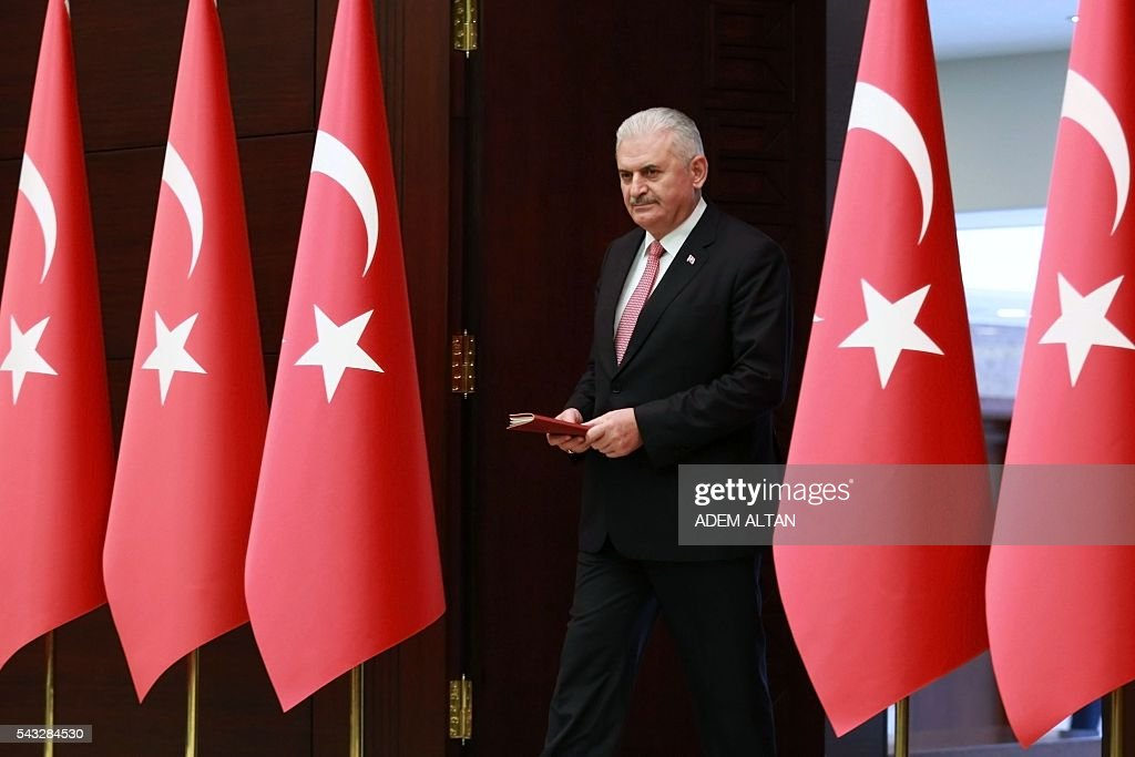 Turkish Prime Minister Binali Yildirim arrives to hold a press conference after a Turkish-Israeli meeting, at the Cankaya Palace in Ankara, on June 27, 2016. A breakthrough Israel-Turkey deal following six years of acrimony will see Israel pay $20 million (18,14 million euros) in compensation for a deadly 2010 commando raid, Turkish Prime Minister Binali Yildirim said on June 27. The deal will also see the two countries exchange ambassadors 'as soon as possible,' Yildirim told a press conference in Ankara. / AFP / ADEM