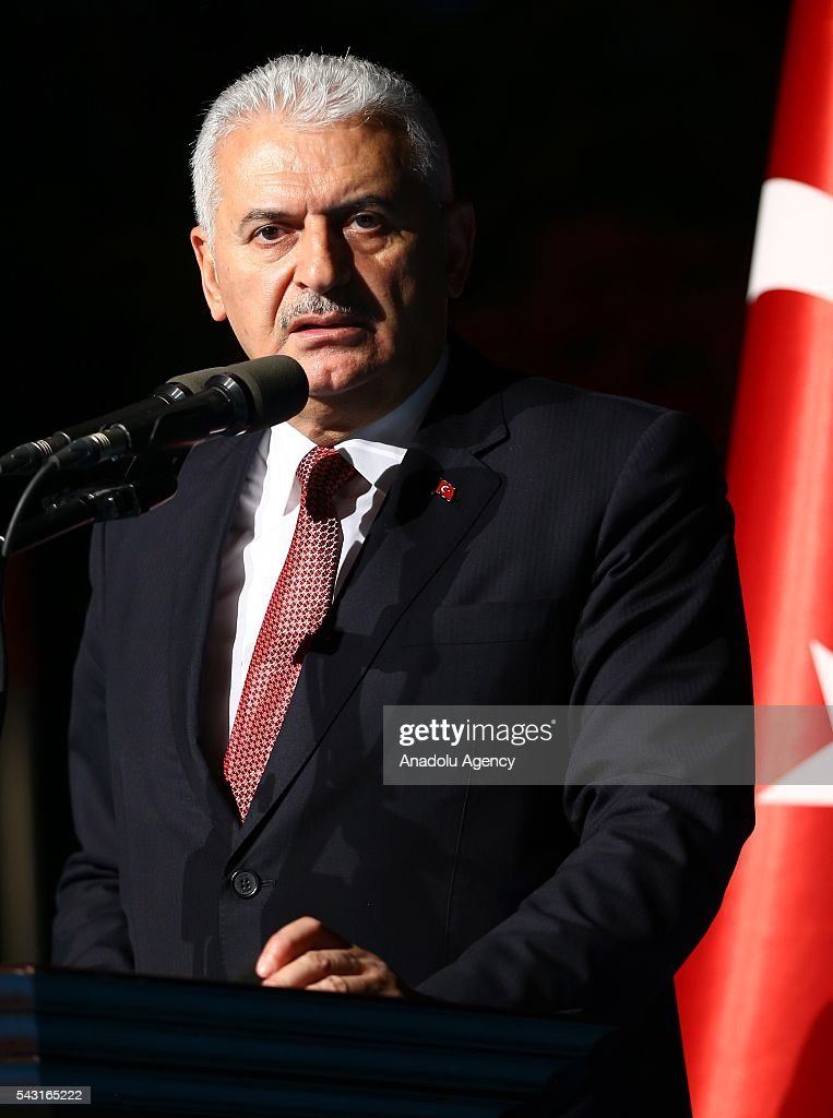 Turkish Prime Minister Binali Yildirim delivers a speech as he attends an Iftar (fast-breaking) Dinner with martyr families during Islamic holy month Ramadan at the Cankaya Mansion in Ankara, Turkey on June 26, 2016.