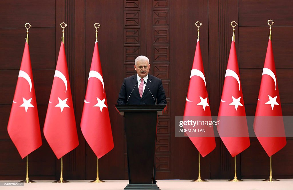 Turkish Prime Minister Binali Yildirim delivers a speech during a press conference after a Turkish-Israeli meeting, at the Cankaya Palace in Ankara, on June 27, 2016. A breakthrough Israel-Turkey deal following six years of acrimony will see Israel pay $20 million (18,14 million euros) in compensation for a deadly 2010 commando raid, Turkish Prime Minister Binali Yildirim said on June 27. The deal will also see the two countries exchange ambassadors 'as soon as possible,' Yildirim told a press conference in Ankara. / AFP / ADEM