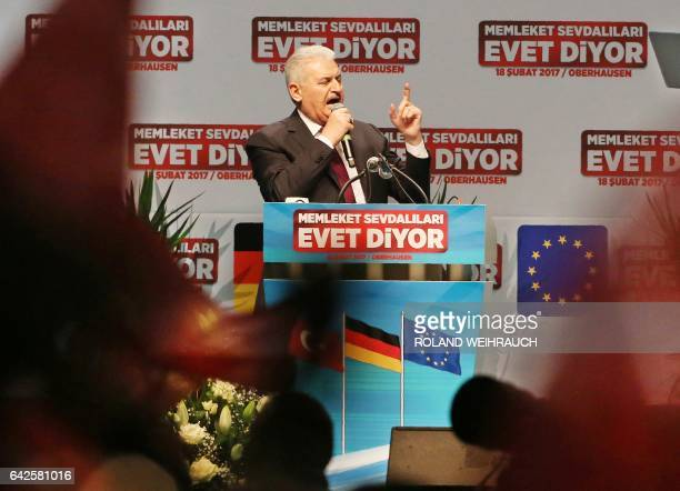 Turkish Prime Minister Binali Yildirim delivers a speech during an event in Oberhausen western Germany on February 18 2017 to promote support for a...