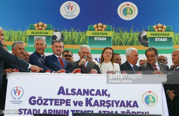 Turkish Prime Minister Binali Yildirim delivers a speech during the opening ceremony of Buca Yasin Boru Youth Centre and groundbreaking ceremony of...