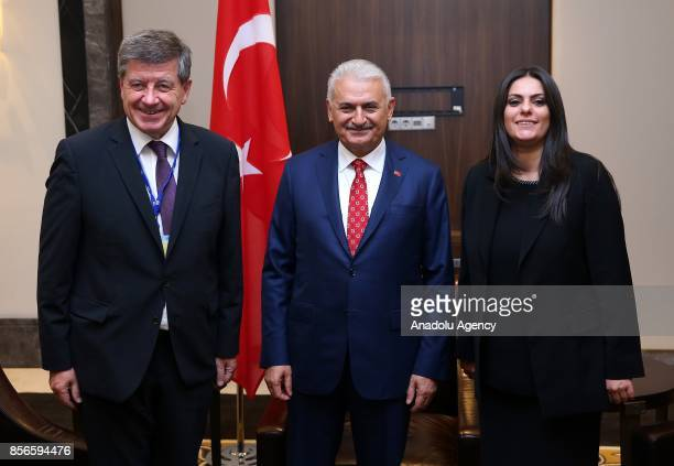 Turkish Prime Minister Binali Yildirim DirectorGeneral of the International Labour Organization Guy Ryder and Turkish Labor and Social Security...