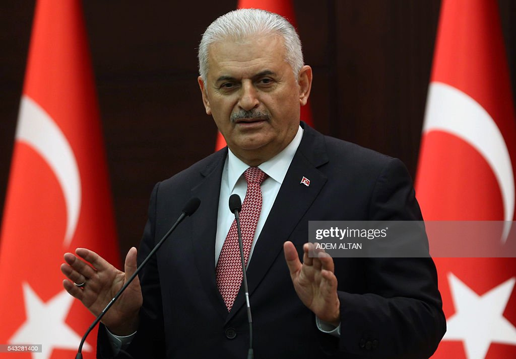 Turkish Prime Minister Binali Yildirim gestures as he delivers a speech during a press conference after a Turkish-Israeli meeting, at the Cankaya Palace in Ankara, on June 27, 2016. A breakthrough Israel-Turkey deal following six years of acrimony will see Israel pay $20 million (18,14 million euros) in compensation for a deadly 2010 commando raid, Turkish Prime Minister Binali Yildirim said on June 27. The deal will also see the two countries exchange ambassadors 'as soon as possible,' Yildirim told a press conference in Ankara. / AFP / ADEM