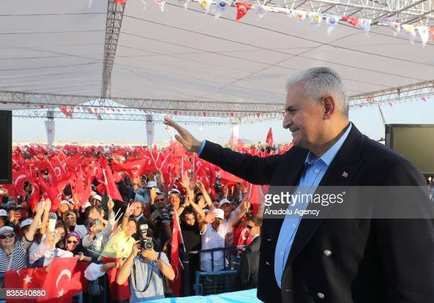 Turkish Prime Minister Binali Yildirim greets people as he attends the groundbreaking ceremony of Konya High Speed Train Station and Konya Logistics...