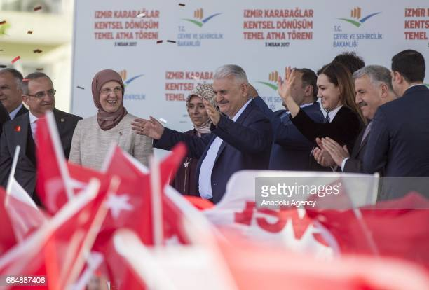 Turkish Prime Minister Binali Yildirim greets the crowd during the groundbreaking ceremony of Urban Transformation Project of Karabaglar district of...