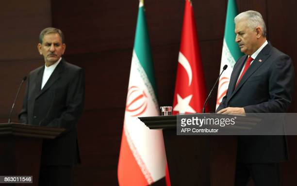 Turkish Prime Minister Binali Yildirim is watched by Iran's First Vice President Eshaq Jahangiri as he addresses a joint press conference at Cankaya...