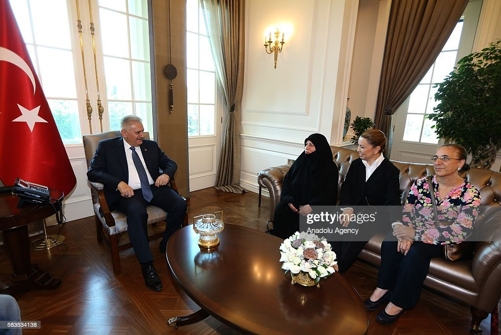 Turkish Prime Minister Binali Yildirim meets with a group of citizens defiant against Parallel State/Gulenist Terrorist Organization's 15th of July...