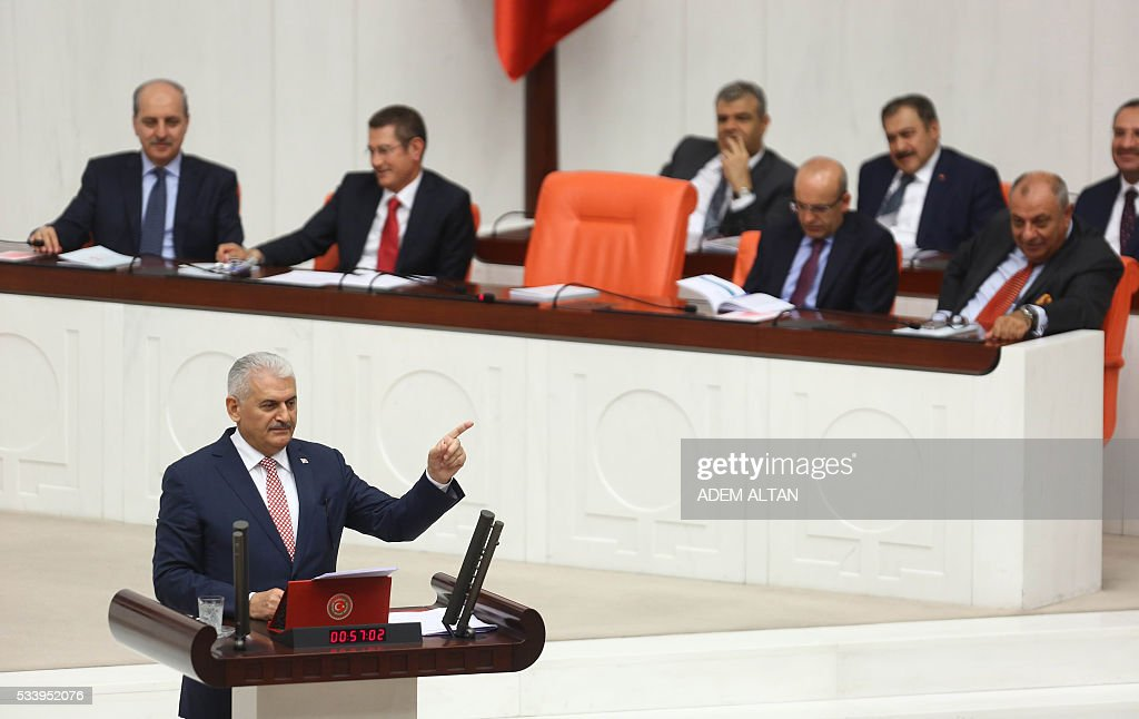 Turkish Prime Minister Binali Yildirim presents the Turkeys 65th government's program to the Grand National Assembly of Turkey (TBMM) in Ankara on May 24, 2016. / AFP / ADEM