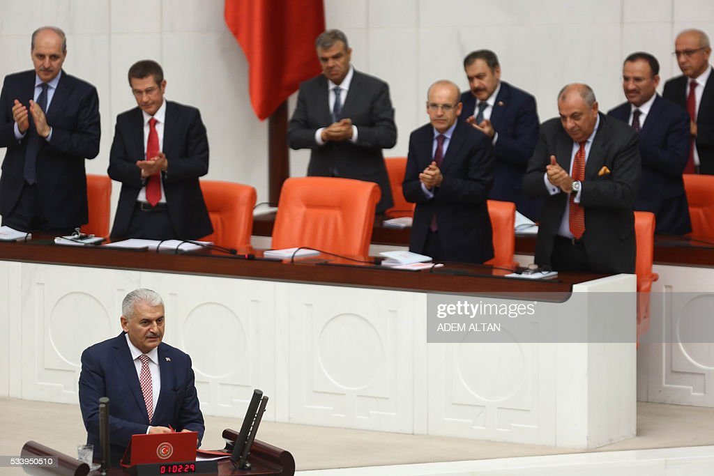 MP's applaud as Turkish Prime Minister Binali Yildirim presents the Turkeys 65th government's program to the Grand National Assembly of Turkey (TBMM) in Ankara, on May 24, 2016. / AFP / ADEM