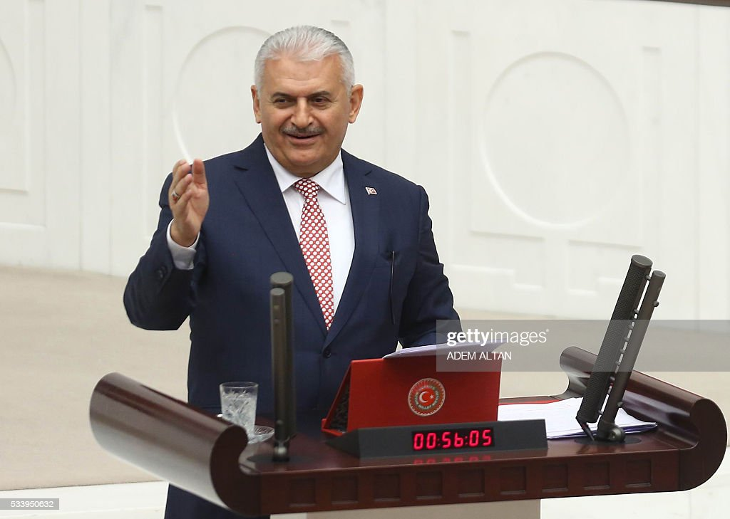 Turkish Prime Minister Binali Yildirim gestures as he presents the Turkeys 65th government's program to the Grand National Assembly of Turkey (TBMM) in Ankara, on May 24, 2016. / AFP / ADEM