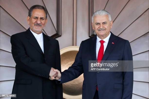 Turkish Prime Minister Binali Yildirim shakes hands with Iranian First Vice President Eshaq Jahangiri prior to their meeting at Cankaya Palace in...