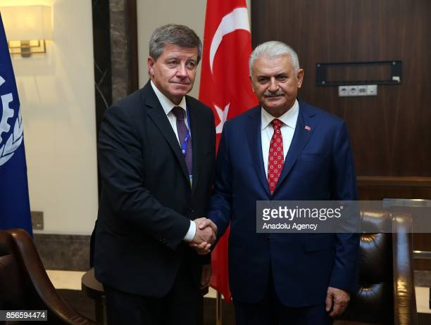 Turkish Prime Minister Binali Yildirim shakes hands with DirectorGeneral of the International Labour Organization Guy Ryder after the 10th European...