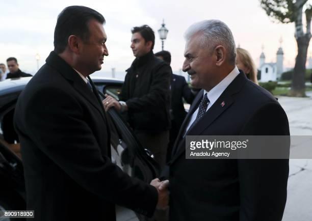 Turkish Prime Minister Binali Yildirim shakes hands with Tajikistani Prime Minister Kohir Rasulzoda ahead of their meeting at the Dolmabahce Prime...