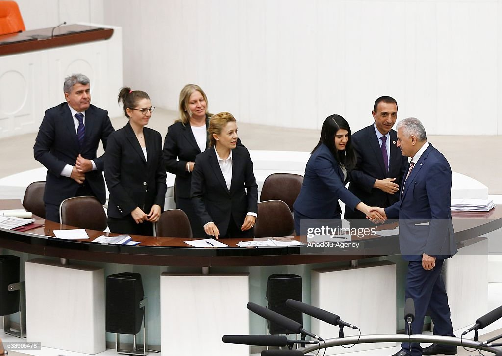 Turkish Prime Minister Binali Yildirim (R) shakes hands with the stenographers after presenting the Turkeys 65th government's program to the Grand National Assembly of Turkey (TBMM) in Ankara, Turkey on May 24, 2016.