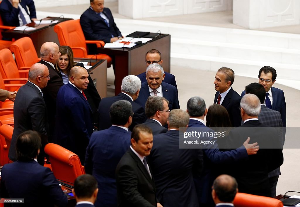 Turkish Prime Minister Binali Yildirim (C) shakes hands with the Republican People's Party (CHP) MPs after presenting the Turkeys 65th government's program to the Grand National Assembly of Turkey (TBMM) in Ankara, Turkey on May 24, 2016.