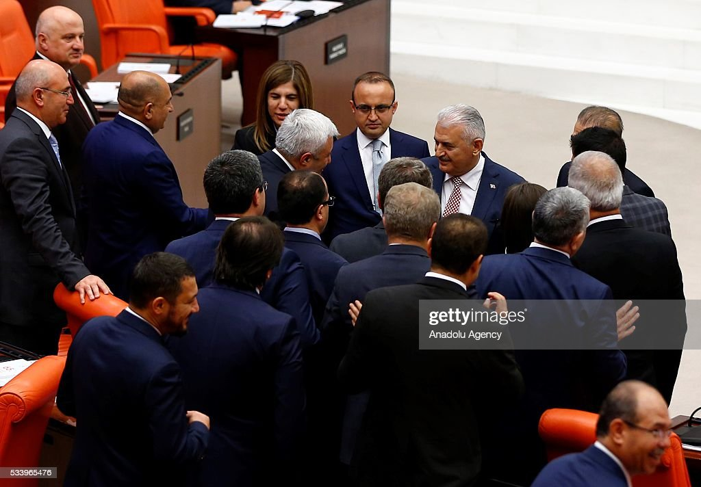Turkish Prime Minister Binali Yildirim shakes hands with the Republican People's Party (CHP) MPs after presenting the Turkeys 65th government's program to the Grand National Assembly of Turkey (TBMM) in Ankara, Turkey on May 24, 2016.