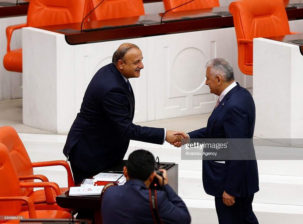 Turkish Prime Minister Binali Yildirim (R) shakes hands with the Turkish Nationalist Movement Party (MHP) Group Deputy Chairman Oktay Vural after presenting the Turkeys 65th government's program to the Grand National Assembly of Turkey (TBMM) in Ankara, Turkey on May 24, 2016.