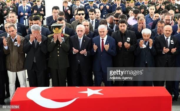 Turkish Prime Minister Binali Yildirim Speaker of the Grand National Assembly of Turkey Ismail Kahraman Head of the Republican People's Party Kemal...