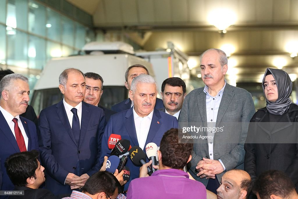 Turkish Prime Minister Binali Yildirim (C) speaks to the media after at least 36 victims and three suicide bombers were killed while scores of others were injured in a terror attack at the Ataturk International Airport in Istanbul, Turkey on June 29, 2016. Turkish Prime Minister Binali Yildirim, Turkish Deputy Prime Minister Numan Kurtulmus (R2), Turkish Minister of Family and Social Policies, Fatma Betul Sayan Kaya (R), Turkish Interior Minister Efkan Ala (L 2) and Turkish Minister of Transport, Maritime and Communication, Ahmet Arslan (L) inspected the scene after the terror attack.