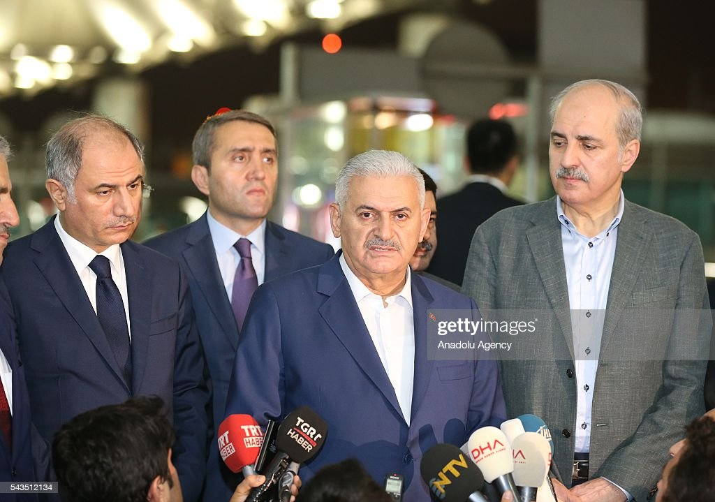 Turkish Prime Minister Binali Yildirim (R 2) speaks to the media after at least 36 victims and three suicide bombers were killed while scores of others were injured in a terror attack at the Ataturk International Airport in Istanbul, Turkey on June 29, 2016. Turkish Prime Minister Binali Yildirim, Turkish Deputy Prime Minister Numan Kurtulmus (R) and Turkish Interior Minister Efkan Ala (L) inspected the scene after the terror attack.