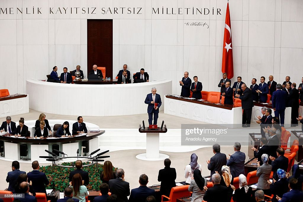 Turkish Prime Minister Binali Yildirim walks up to the podium to present the Turkeys 65th government's program to the Grand National Assembly of Turkey (TBMM) in Ankara, Turkey on May 24, 2016.